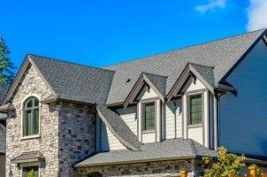 stone-siding-under-light-asphalt-shingling-300x199
